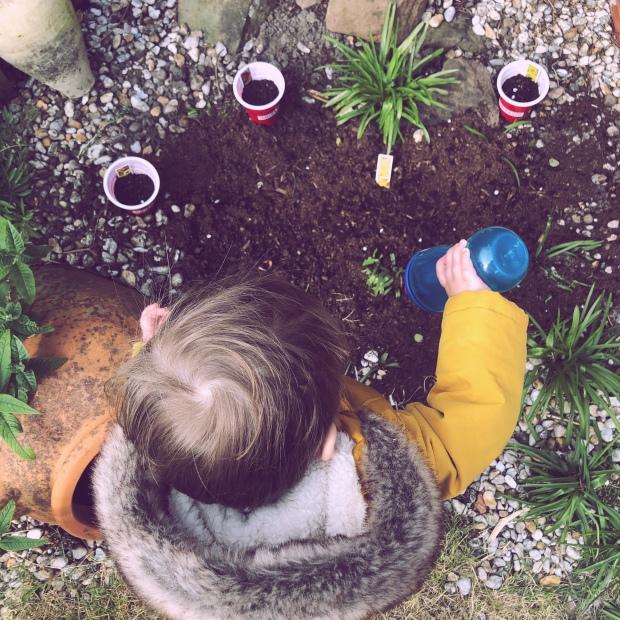 Baby watering garden
