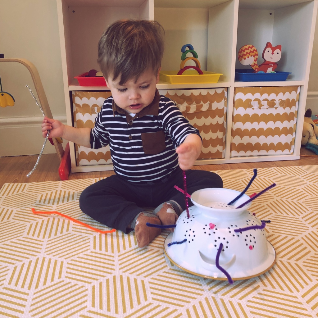 Baby boy colander and pipe cleaners