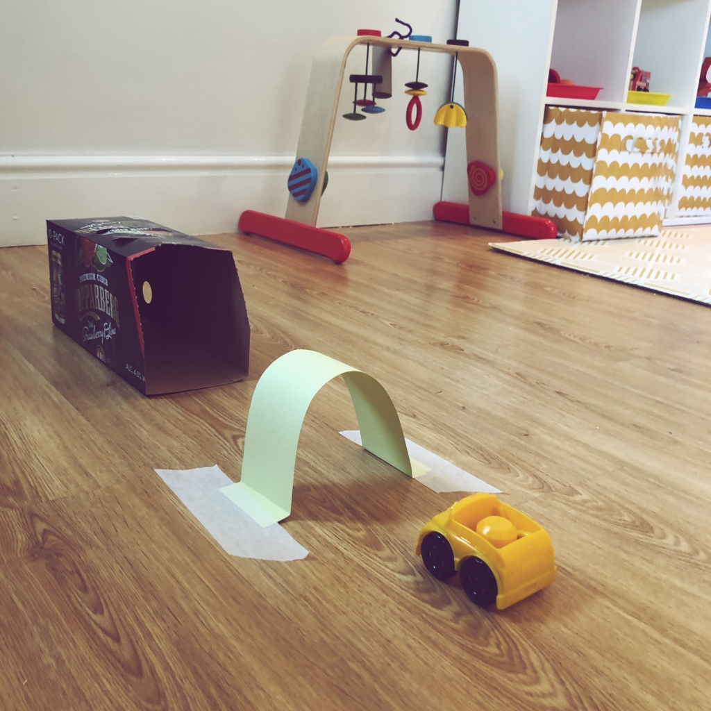 Toy car with cardboard tunnel and garage