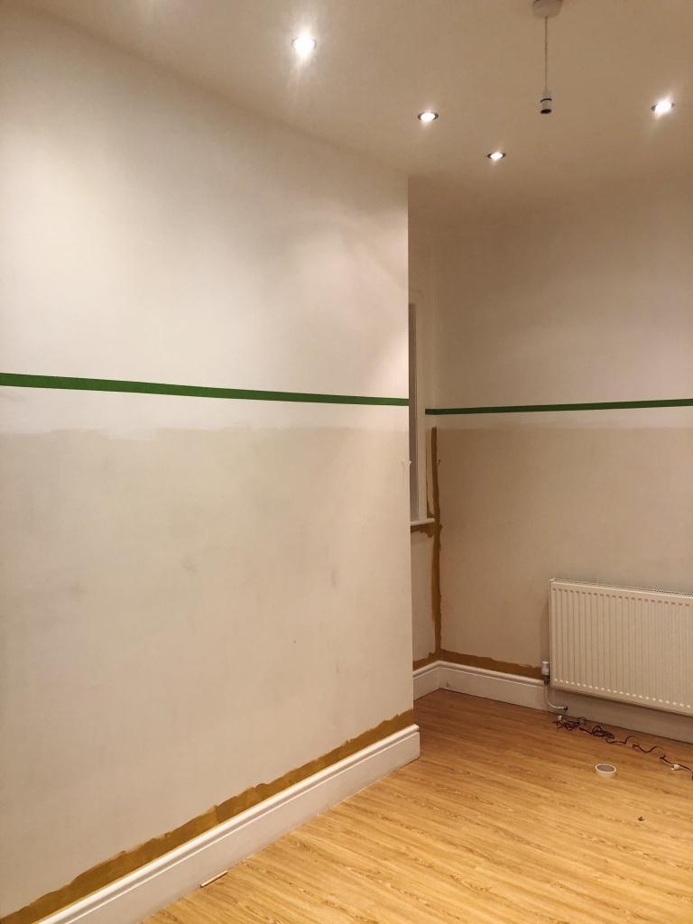 Beige wall frog tape line
